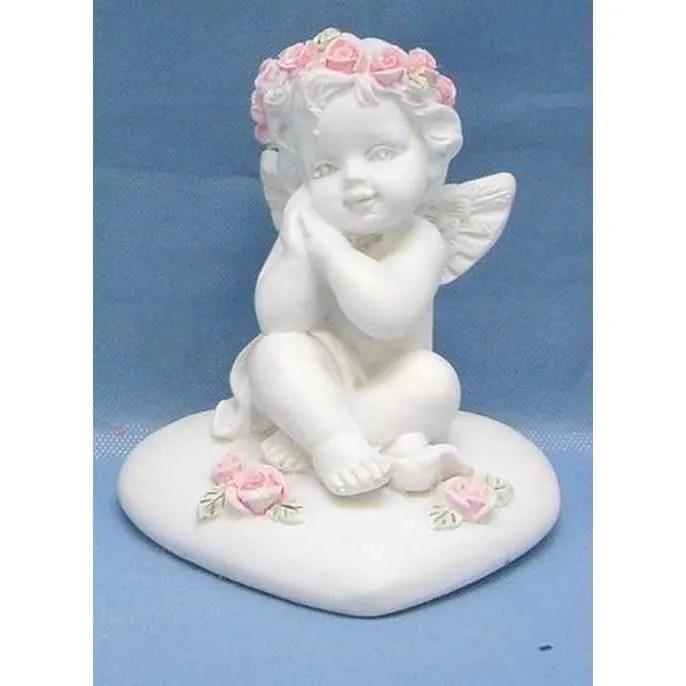 figurine cherubin ange avec fleurs sur coeur