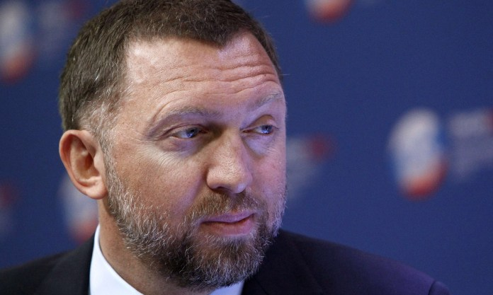 Russian-tycoon-Oleg-Deripaska-takes-part-in-a-discussion-meeting-at-the-St.-Petersburg-International-Economic-Forum-in-St.-Petersburg_1391800308944217.jpg