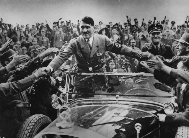 hitler-in-crowd-3324060-58d6b54a5f9b584683a4d84e.jpg