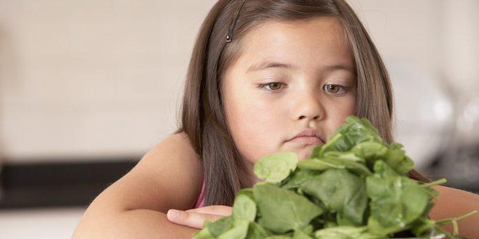 o-KID-EATING-VEGETABLES-facebook.jpg