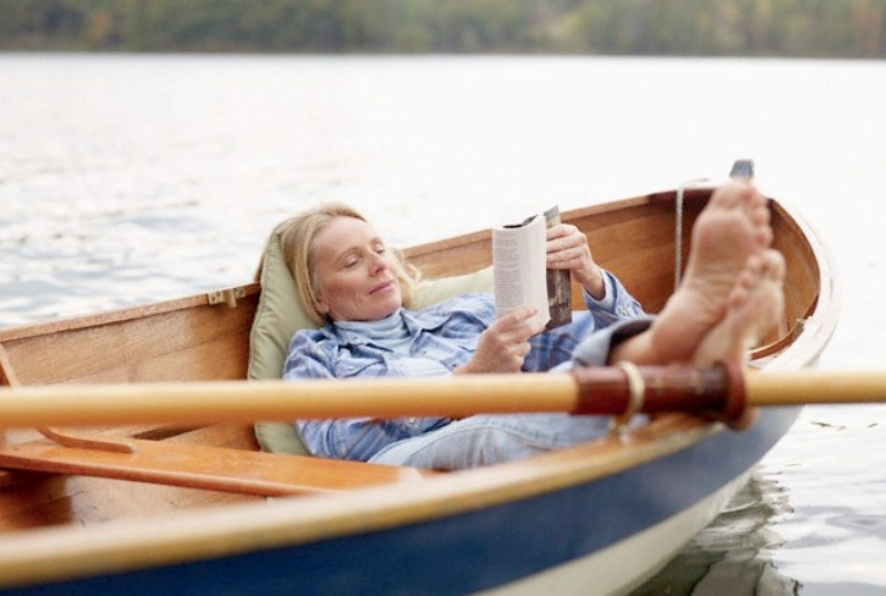 woman-with-feet-up-reading-book-in-canoe.jpg