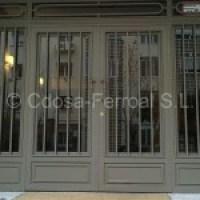Puertas de portales de hierro y forja. Portales comunidad de vecinos