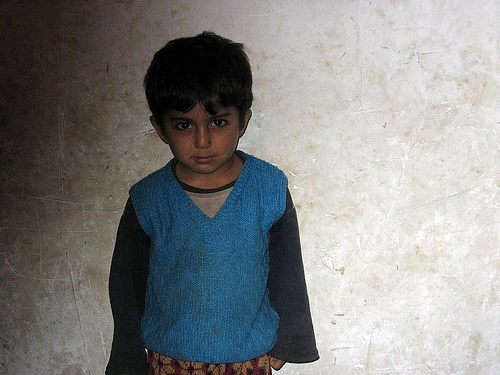 A young Afghan refugee in Dalaki.  Photo credited to unicefiran on Flickr.