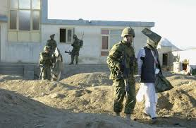 Canadian soldiers leading detainees