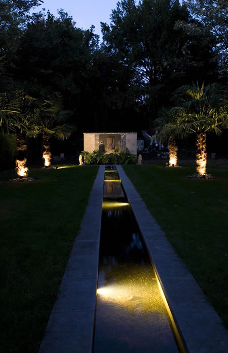 A City Garden With Water Rill