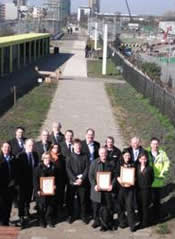 Picture 7: The team receiving their award on the Greenway