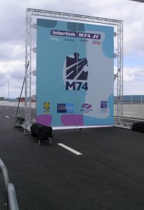 The ceremonial opening banner for M74