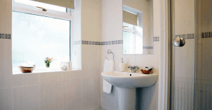 bathroom with modern free standing shower