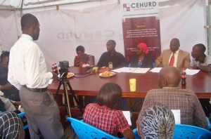 Mr. Mubangizi Micheal and Musimenta Jennifer (holding baby) during a press conference