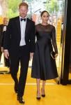 Il principe Harry, duca di Sussex (sinistra) e la britannica Meghan, duchessa di Sussex (destra) arrivano per assistere alla prima europea del film Il re leone a Londra il 14 luglio 2019.