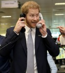 Britain's Prince Harry, the Duke of Sussex completes a trade as he attends the 15th annual BGC Charity Day, in London, Wednesday, Sept. 11, 2019. The day is held each year by BGC Partners to commemorate the 658 Cantor Fitzgerald and the 61 EuroBrokers emp
