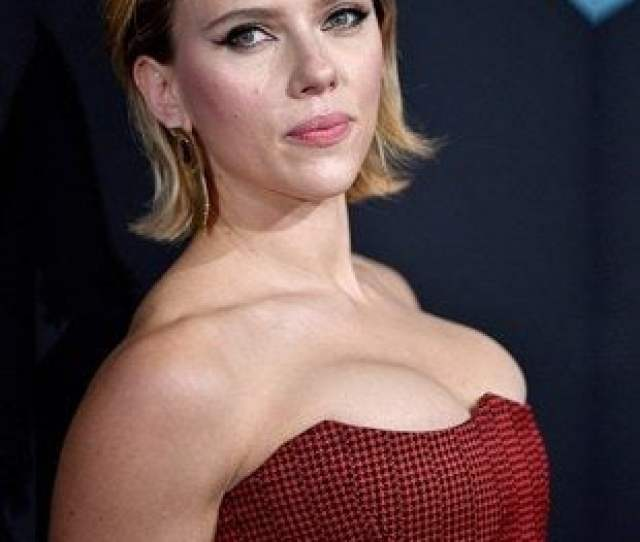 Scarlett Johansson With Her Boobs Pushed Up Fondling A Dildo