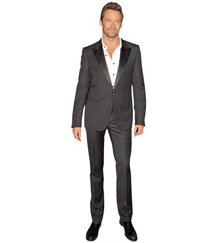 A Lifesize Cardboard Cutout of Hugh Jackman wearing a casual suit