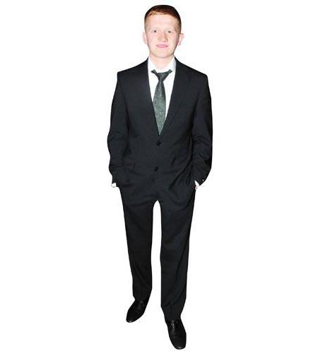 A Lifesize Cardboard Cutout of Sam Aston wearing suit and tie