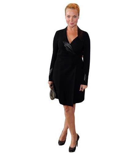 A Lifesize Cardboard Cutout of Samantha Womack wearing a dress coat