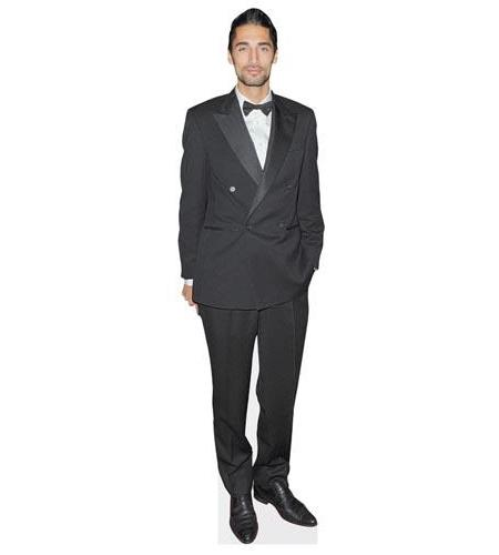 A Lifesize Cardboard Cutout of Hugo Taylor wearing a black suit