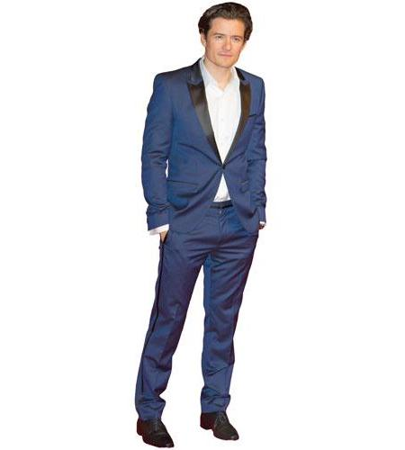 A Lifesize Cardboard Cutout of Orlando Bloom wearing a suit