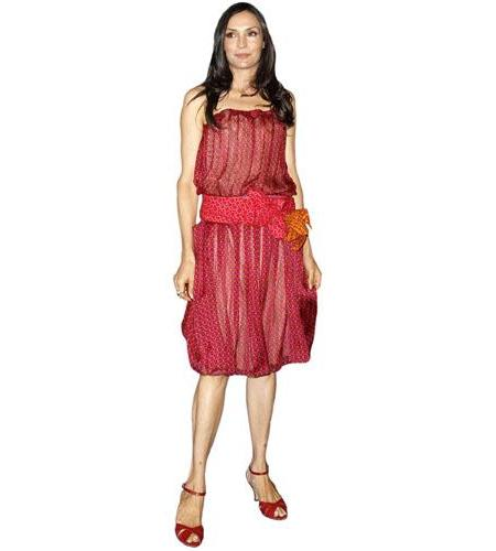 A Lifesize Cardboard Cutout of Famke Janssen wearing a red dress