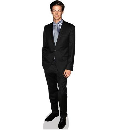 A Lifesize Cardboard Cutout of Grant Gustin wearing a suit
