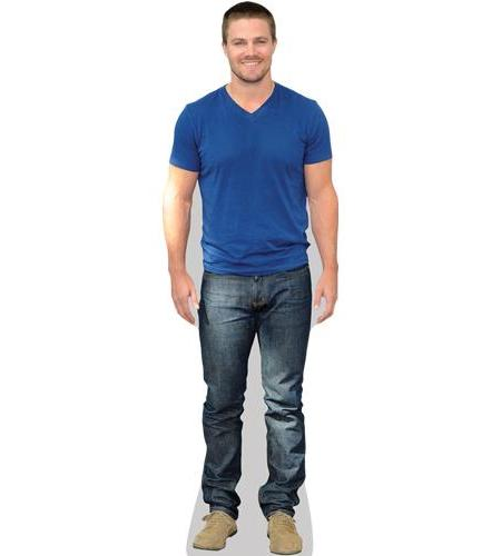 A Lifesize Cardboard Cutout of Stephen Amell wearing jeans and t-shirt