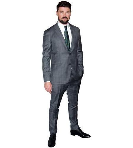 A Lifesize Cardboard Cutout of Karl Urban wearing a suit