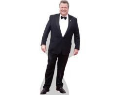 A Lifesize Cardboard Cutout of Eric Stonestreet wearing a suit
