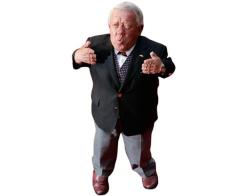 A Lifesize Cardboard Cutout of Kenny Baker wearing a suit