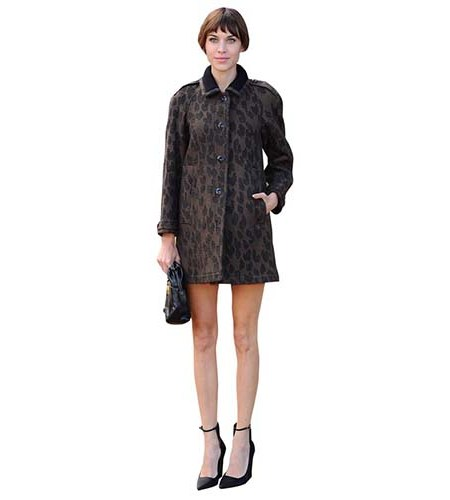 A Lifesize Cardboard Cutout of Alexa Chung wearing a coat and heels