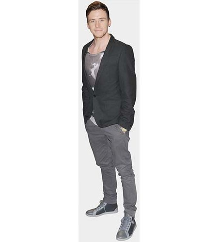 A Lifesize Cardboard Cutout of Danny Jones wearing a jacket and slim trousers