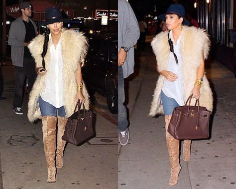 Kim Kardashian in Valentino Rockstud Suede Boots and Jahaanara Gilet Lamb Fur Vest