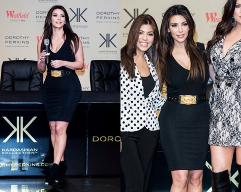Kim Kardashian in Kardashian Kollection Black V Neck Dress