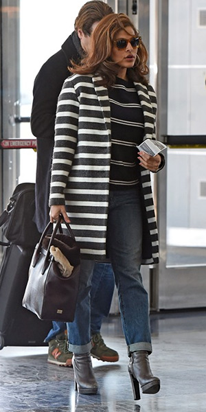 Eva Mendes at JFK airport wearing MOTHER The Brother Jeans