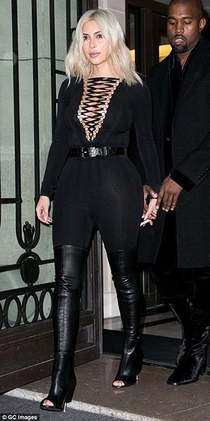 Kim Kardashian in Paris wearing a Givenchy bodysuit and Givenchy Nunka Stretch Nappa Boots