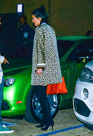 Kylie Jenner wearing a Bouchra Jarrar leopard print bomber coat while arriving at Nobu in Los Angeles, CA on July 12, 2015.