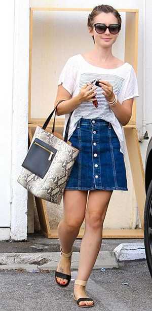 Lily Collins wearing a Paige Elodie Shirt, IVI sunglasses, a Vince Camuto Tami bag, AG Alexa Chung x AG Kety Denim Skirt and Yosi Samra Cambelle Flat Sandals while out and about on August 25, 2015 in Beverly Hills, CA.