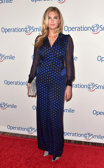 Kate Upton wearing a Diane Von Furstenberg Cathy Printed Silk Jumpsuit to Operation Smile's 2015 Smile Gala on October 2, 2015 in Beverly Hills, CA.