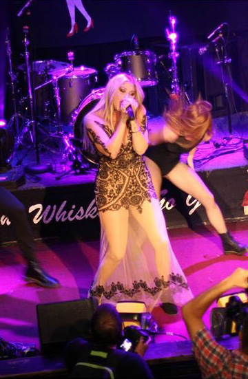 "Taylor Ann Hasselhoff wearing For Love & Lemons Lotus Maxi Dress while performing at the ""Cure Rocks…Where Music + Cause Collide"" Stopcancer.org Benefit Concert in West Hollywood, CA on October 12, 2015."