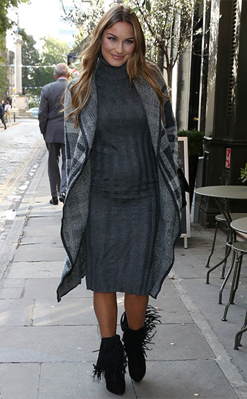 Sam Faiers spotted in London, England in a Stitch & Pieces Roll Neck Rib Bodycon Midi Dress and suede fringe boots on September 17, 2015.