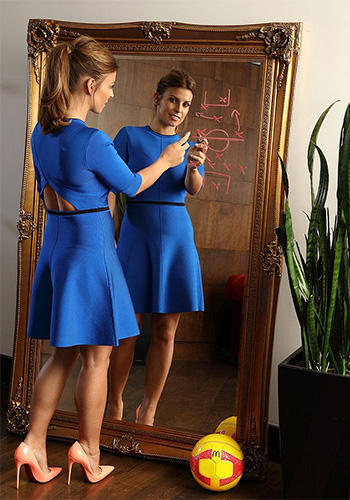Coleen Rooney poses in a Victoria Victoria Beckham Moroccan Blue Open Back Dress for McDonald's Football Mum Of The Year 2016.