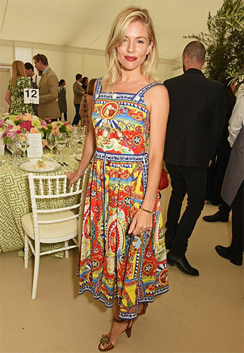 Sienna Miller wears a Dolce & Gabbana Carretto Siciliano Print Dress to the Cartier Queen's Cup Polo at Guards Polo Club on June 11, 2016 in London, England.