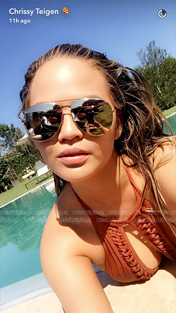 Chrissy Teigen wears Dior Side Split Mirrored Sunglasses and a Tularosa Clemence One Piece to the REVOLVE Fourth of July Party in The Hamptons on July 4, 2016.
