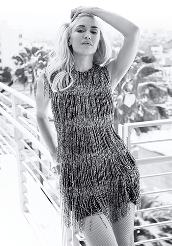 Gwen Stefani in a Burberry Prorsum Bugle Bead Fringe Shift Dress for Harper's Bazaar US August 2016.