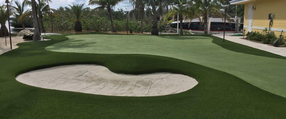 FL backyard putting green with white sand bunker