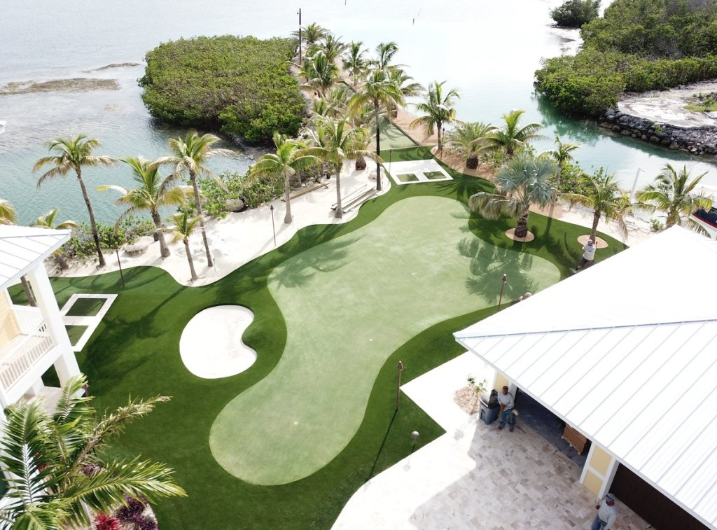 Overhead view of Florida synthetic turf putting green with bunker on ocean