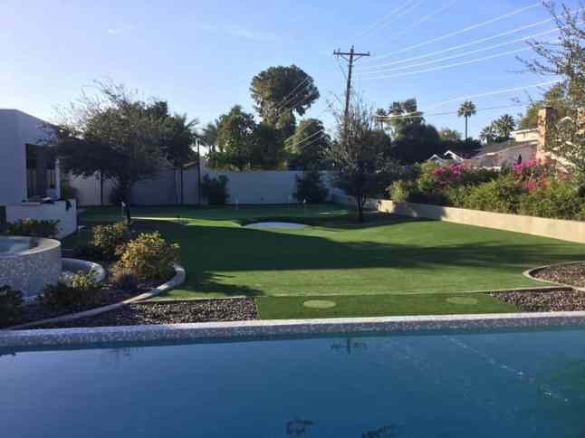 backyard artificial grass golf putting green next to pool