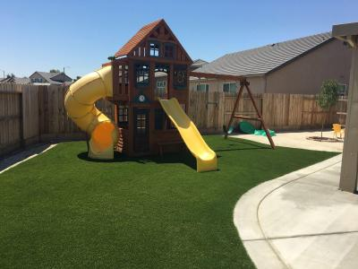 arizona backyard artificial grass landscaping with playground