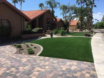 Artificial landscaping turf in the front yard of an Arizona home