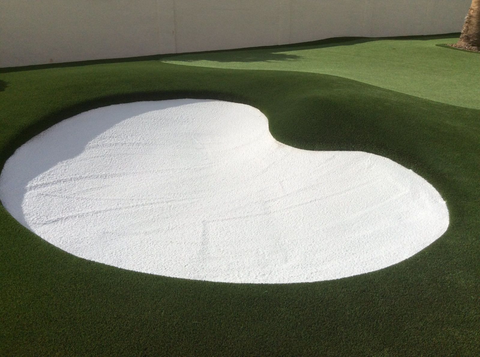 artificial grass backyard putting green with white sand bunker
