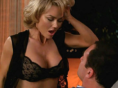 Kelly Carlson riding a guy in a chair