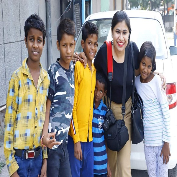 pic of her with poor kids